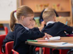 Education Secretary John Swinney said getting children back in school is a priority (PA)