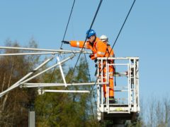 A 30-year rolling programme of rail electrification projects is vital for the industry to cut its carbon emissions, according to MPs (Danny Lawson/PA)