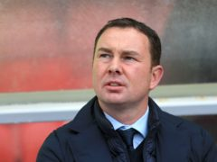 Derek Adams' Morecambe are in contention for promotion (Nigel French/PA)