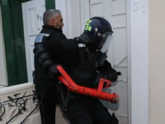 Police raid an address as part of a crackdown on people trafficking (Owen Humphreys/PA)