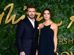 David and Victoria Beckham led the celebrities celebrating International Women's Day (Ian West/PA)