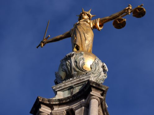 FW Pomeroy's Statue of Justice stands atop the Central Criminal Court building, Old Bailey, London. (Jonathan Brady/PA)