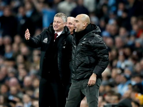 Ole Gunnar Solskjaer, left, and Pep Guardiola's sides go head-to-head on Sunday (Martin Rickett/PA)