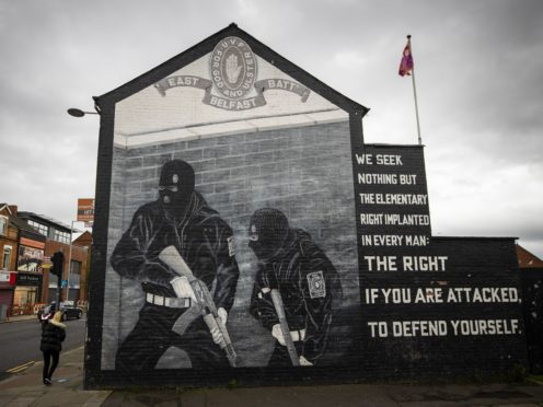 """Ulster Volunteer Force (UVF) mural in support the of Ulster loyalist paramilitary group, on the wall of a property on the Lower Newtownards Road in east Belfast. Paramilitarism remains a """"clear and present danger"""" in Northern Ireland, a new report has found. The Independent Reporting Commission (IRC) said it understands from police that there remains thousands of """"signed up"""" paramilitary members."""