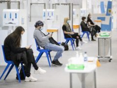Health and social care staff wait in the rest area after receiving their coronavirus vaccines at the NHS Louisa Jordan Hospital in Glasgow, as part of a mass vaccination drive by NHS Greater Glasgow and Clyde. Picture date: Saturday January 23, 2021.