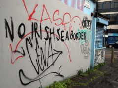 Graffiti reading 'No Irish Sea border' Stroud Street in Belfast. The DUP has rejected claims it is whipping up tensions over Irish Sea trade in an effort to get Brexit's contentious Northern Ireland Protocol ditched. Physical inspections on goods entering Northern Ireland from Great Britain, which are required under the protocol, have been suspended amid threats and intimidation of staff. Picture date: Wednesday February 3, 2021.
