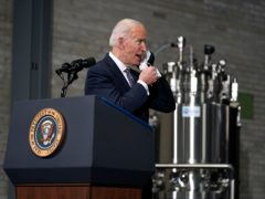 US President Joe Biden has been pictured wearing two masks at once (Evan Vucci/AP)