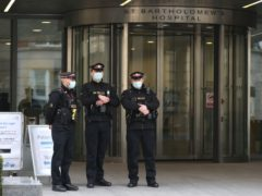 Officers from the City of London Police outside St Bartholomew's Hospital in London (PA)