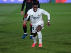 Vinicius Junior rescued a late point for Real Madrid (Bernat Armangue/AP)