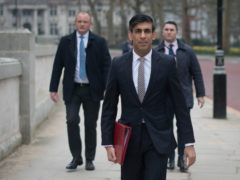 Chancellor Rishi Sunak walks from the Treasury to No 11 Downing Street (Stefan Rousseau/PA)