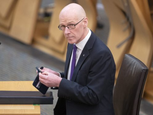 The Tories are to lodge a no confidence vote in John Swinney (Jane Barlow/PA)