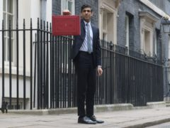 Chancellor Rishi Sunak stands outside 11 Downing Street (PA)