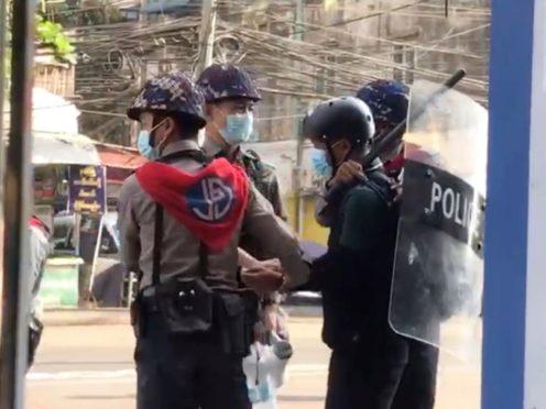 Associated Press journalist Thein Zaw is arrested by police in Yangon on February 27 (AP)