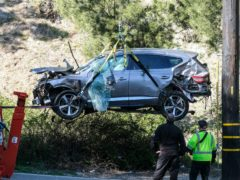 A crane is used to lift the vehicle Tiger Woods was driving in the crash (Ringo HW Chiu/AP)