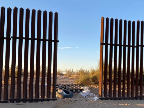 Thirteen people killed in one of the deadliest US border crashes on record entered the US through this hole cut into southern California's border fence with Mexico, according to the US Border Patrol (US Customs and Border Protection/AP)