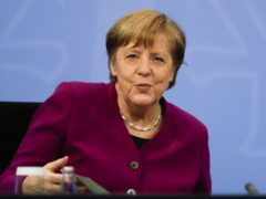 German Chancellor Angela Merkel attends a news conference (Markus Schreiber, Pool/AP)