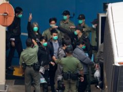 Pro-democracy activists being escorted to a prison van (Kin Cheung/AP)