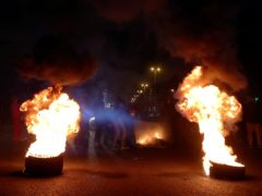 Protesters burn tyres to block a main highway in the town of Jal el-Dib, north of Beirut, Lebanon (AP)
