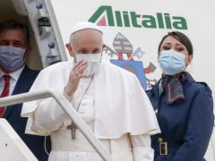 Pope Francis gives a blessing as he prepares to fly to Baghdad from Fiumicino's International airport Leonardo da Vinci, near Rome (Cecilia Fabiano/ LaPresse/AP)