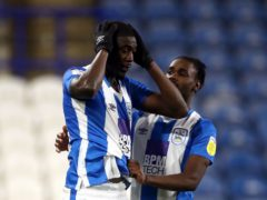 Yaya Sanogo, left, missed a penalty for Huddersfield (Tim Goode/PA)