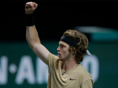 Andrey Rublev celebrates victory over Stefanos Tsitsipas in Rotterdam (Peter Dejong/AP)