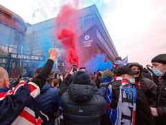 Fans celebrate outside Ibrox after Rangers win the Scottish Premiership title (Jane Barlow/PA)