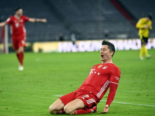 Robert Lewandowski's treble saw Bayern Munich emerge victorious from a thrilling Der Klassiker (Sven Hoppe/Pool via AP/AP/Press Association Images)