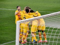 Barcelona boss Ronald Koeman hailed his side's fighting qualities (Alvaro Barrientos/AP)