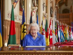 The Queen signs her annual Commonwealth Day message (Steve Parsons/PA)
