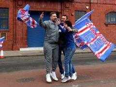 Fans celebrate outside Ibrox after Rangers win the Scottish Premiership title (Jane Barlow/PA)