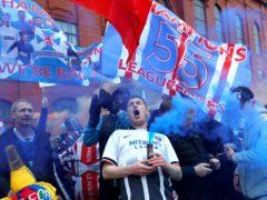 Rangers fans celebrate outside Ibrox (Robert Penny/PA).