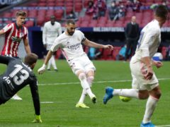 Karim Benzema, centre, helped Real Madrid claim a share of the spoils at Atletico (Manu Fernandez/AP/PA)