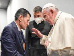 Pope Francis speaks to Abdullah Kurdi (Vatican Media via AP)