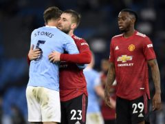 Manchester City's John Stones, left, hugs Manchester United's Luke Shaw at the end of the Premier League match at the Etihad Stadium (Peter Powell/PA)