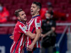 Luis Suarez celebrates scoring his penalty (Bernat Armangue/AP)