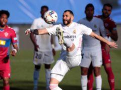Karim Benzema earned a dramatic late victory for Real Madrid (Bernat Armangue/AP)