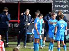 Cheltenham manager Michael Duff (second left) liked what he saw from his team at Exeter (Simon Galloway/PA)