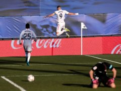 Karim Benzema scored a late double to lift Real to victory (Bernat Armangue/AP)