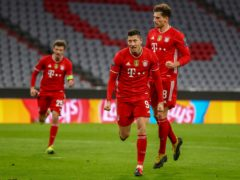Bayern's Robert Lewandowski celebrates his opener in the win over Lazio. (Matthias Schrader/AP)