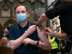 Dr Jan Maniera administers an injection of the AstraZeneca coronavirus vaccine to chief executive of the NHS Sir Simon Stevens at Westminster Abbey, London (Aaron Chown/PA)
