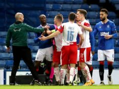 Tempers flare at Ibrox as Rangers' Glen Kamara is held back from Slavia Prague's Ondrej Kudela and a Uefa official intervenes (Andrew Milligan/PA)