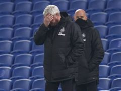 Newcastle boss Steve Bruce, left, cut a dejected figure in Saturday's defeat at Brighton (John Walton/PA)