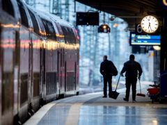 A worker cleans the platform at the central station in Frankfurt, Germany (Michael Probst/AP)
