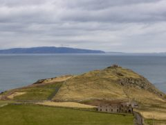 A view from Torr Head on the north Antrim coast looking over the Straits of Moyle towards the tip of the Mull of Kintyre (PA)