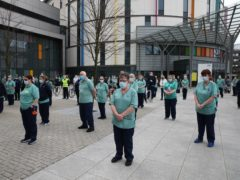 Staff observe a minute's silence outside the Queen Elizabeth University Hospital in Glasgow (Andrew Milligan/PA)
