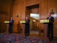 Left to right, chief scientific adviser Sir Patrick Vallance, Prime Minister Boris Johnson and England's chief medical officer Professor Chris Whitty during a media briefing in Downing Street (Hannah McKay/PA)