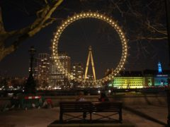The London Eye in London is illuminated yellow during the National Day of Reflection (Yui Mok/PA)
