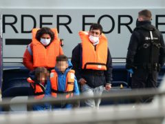 A young family among a group of people thought to be migrants are brought in to Dover, Kent (Gareth Fuller/PA)