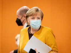 German Chancellor Angela Merkel arrives for the weekly cabinet meeting of the German government (Kay Nietfeld/Pool via AP)