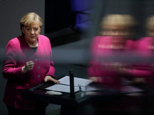 German Chancellor Angela Merkel addresses the German parliament Bundestag ahead of an European Union summit at the Reichstag building (Markus Schreiber/AP)